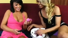 Busty brunette hottie and her sexy blonde gal pal have fun playing with toys