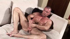 Jake Lewis shows off his amazing body and pleases himself on the couch