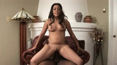 Estelle Leone gets on top of a black stick and rides it with passion