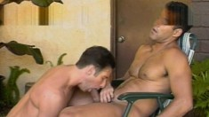 He sucks dick on the lounge chair and then gets his ass drilled by the pool