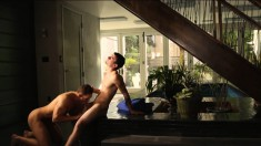 Two muscled male lovers start with oral sex and end with anal on the staircase
