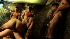 Horny twink in a red beret sucks cocks and gets anally fucked in an all-male orgy