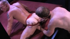 Kinky stud has his gorgeous boyfriend's fist stretching his juicy ass