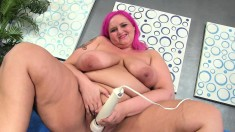 Pink haired plumper with massive hooters enjoys her time with sex toys