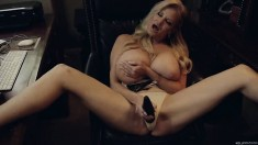 Blonde MILF with gigantic boobs smokes