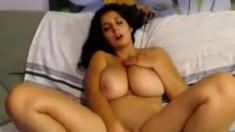 Brunette posing her huge big tits