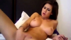 Brunnette playing with dildo on cam